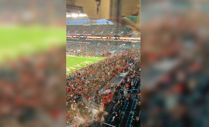 Watch Miami Hurricanes fans catch cat in American flag after insane fall from upper deck